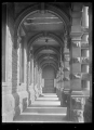 View under arches of an outside passageway at the Dunedin Railway Station. ATLIB 290339.png