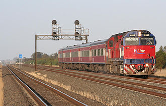 Warrnambool railway line - N class locomotive hauled train running near Lara