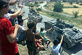WARRIOR ARMOURED PERSONNEL CARRIERS ARE CHEERED ON AS THEY PASS REFUGEES. SOUTHERN KOSOVO BORDER. 12-09-1999 MOD 45108827.jpg