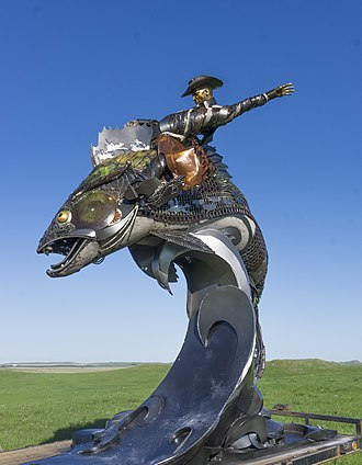 Mobridge, South Dakota - This scrap metal sculpture of a cowboy riding a walleye is on the south end of main street in Mobridge.