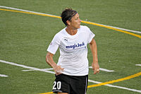 Wambach in a football pitch wearing the MagicJack uniform.