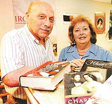 Stanley Weintraub and his wife Rodelle Weintraub among their books