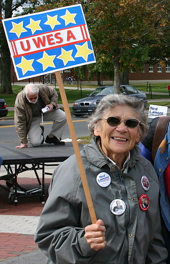 A woman holds a Clark sign with one of his 2004 slogans at a Ned Lamont rally Clark attended in 2006 Wesley Clark UWESA.jpg