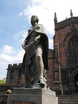 St Peter's Collegiate Church - Statue of Wulfrun bearing her charter, on the church steps, by Charles Wheeler (sculptor).