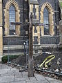 Wooden Cross in Southwark Cathedral churchyard in March 2011 - levels.jpg