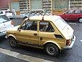 Yellow Polski Fiat 126p 650E in Hungary.jpg