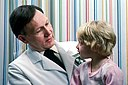Young girl sits on doctor's lap.jpg