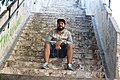 Young man in Brazil sitting on steps.jpg