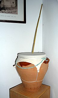 Friction drum class of musical instruments made with stick poking through a membrane stretched over a pot