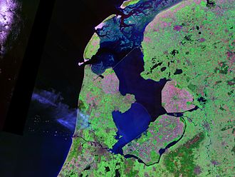 Zuiderzee Works - Landsat photo of the IJsselmeer and surroundings. The difference between the old land (predominantly green), and the new lands (gained from the sea, predominantly purple) is striking. Compare with the figure above.