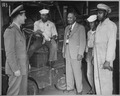 """Lester Granger, while inspecting facilities for Negro personnel at NAS, San Diego, CA, stops to chat with Rofes Herring - NARA - 520687.tif"