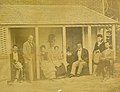 """""""Old Muegge Home"""" (Residence of August Muegge, Cheltenham), Muegge and family pose on porch.jpg"""