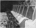 """Roosevelt Dam. View of south spillway showing concrete removal and chipping of piers."" - NARA - 294617.tif"