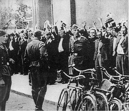 Lapanka - Polish civilian hostages captured by German soldiers on the street, September 1939 Lapanka.jpg