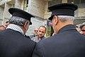 اهداء پرچم حرم علی بن موسی الرضا به هیئت ها یا موکب های مستقر در شهر مهران در ایام پیاده روی اربعین 26.jpg
