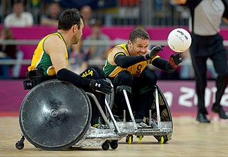 Wheelchair rugby at the 2012 Summer Paralympics - Greg Smith unloads a pass at the London 2012 Games