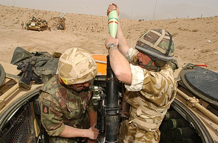 British soldiers engage Iraqi Army positions with their 81mm Mortars south of Basra, 26 March 2003. 1 RRF engage Iraqi Army positions with their 81mm Mortars. Iraq. 26-03-2003 MOD 45142764.jpg