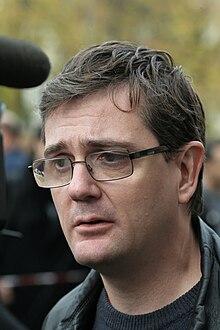220px-2011-11-02_Incendie_%C3%A0_Charlie_Hebdo_-_Charb_-_06.jpg