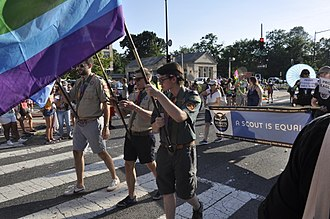 Boy Scouts of America - LGBT Boy Scouts and their supporters at 2017 Capital Pride parade carrying flags and A Scout is equal sign.