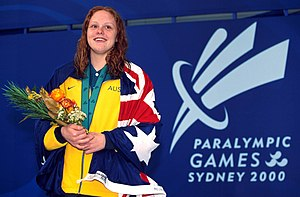 Swimming at the 2000 Summer Paralympics - Australian swimmer Siobhan Paton on the gold medal podium for her win in the 100 m freestyle S14 at the 2000 Summer Paralympics. Paton won six gold medals at these games.
