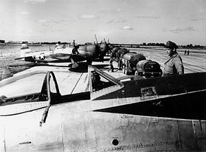 Tour-en-Bessin Airfield - Ground personnel of the 406th Fighter Group refuel P-47 Thunderbolts, including (serial number 44-33057) at Tour-en-Bessin Airfield