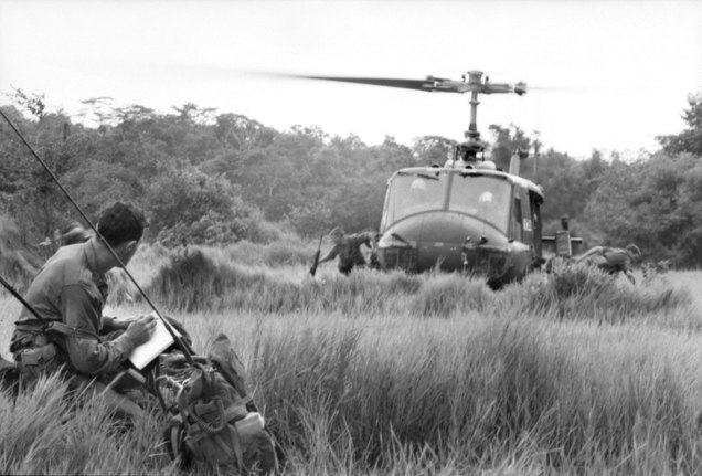 5 RAR soldiers disembarking from a US Army helicopter during Operation Toledo in 1966
