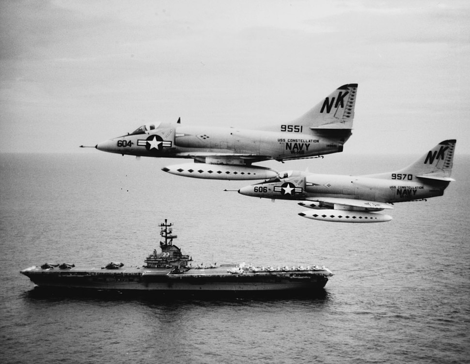A-4C Skyhawks of VA-146 fly past USS Kearsarge (CVS-33) in the South China Sea on 12 August 1964 (USN 1107965)