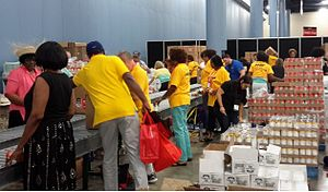AARP volunteers packing food for older Americans in need at a packing event in Miami.