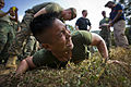 A Thai marine receives an electric shock from a stun gun while participating in a nonlethal weapons training demonstration held by U.S. Marines with the 3rd Platoon, Alpha Company, 3rd Law Enforcement Battalion 140211-M-IJ457-016.jpg