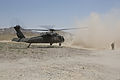 A U.S. Army Special Forces Soldier provides security as a UH-60 Black Hawk helicopter takes off after a clinic opening ceremony in Mya Neshin district, Kandahar province, Afghanistan, June 1, 2013 130601-A-IS772-302.jpg