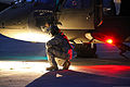 A U.S. Army UH-60 Black Hawk helicopter crew member assigned to the Puerto Rico Army National Guard inspects the aircraft prior to conducting night flight training at the aviation support facility in Isla 140902-Z-KD550-781.jpg
