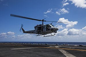 A U.S. Marine Corps UH-1N Iroquois helicopter assigned to Marine Medium Tiltrotor Squadron (VMM) 266 prepares to land aboard the amphibious assault ship USS Kearsarge (LHD 3) in the Atlantic Ocean March 20 130320-M-SO289-011.jpg