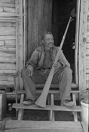 Marshall, Texas - A former slave displays a horn in 1939 that was formerly used by planters to call slaves on the outskirts of Marshall. Many freedmen moved to Marshall from rural areas during Reconstruction, creating their own community and seeking the chance to live away from the supervision of whites. After Union troops departed at the end of Reconstruction, Democrats formed the White Citizens Party, establishing an insurgent militia dedicated to white supremacy.