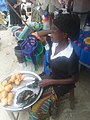 A girl selling okpa.jpg