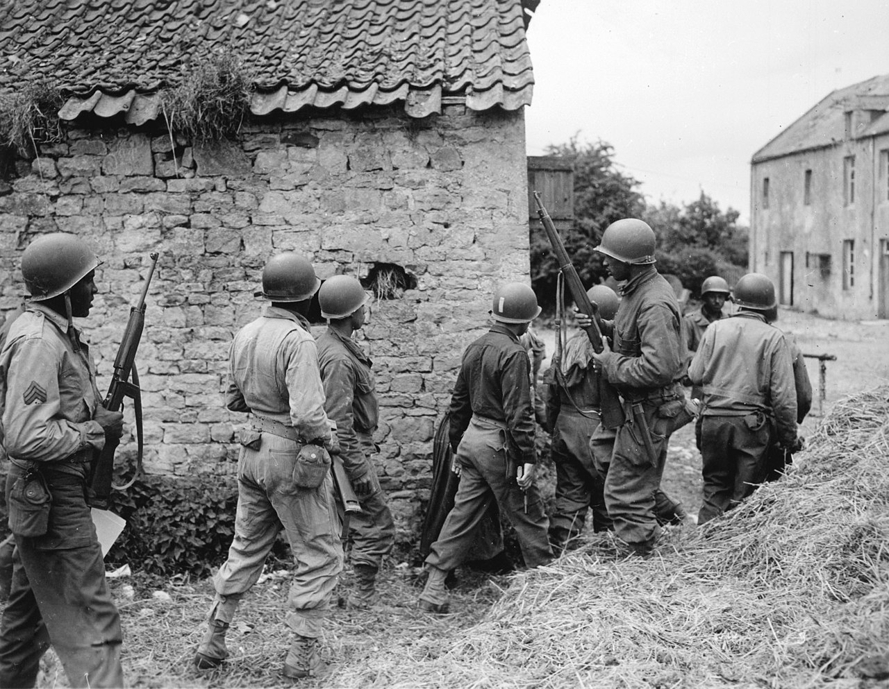 File A Platoon Of Negro Troops Surrounds A Farm House In A