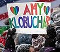 A supporter of Senator Amy Klobuchar holds an Amy Klobuchar sign at a rally where Klobuchar announced her 2020 presidential bid (40090515193) (cropped).jpg