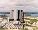 Aerial view of the Apollo 11 Saturn V rollout from the Vehicle Assembly Building.jpg