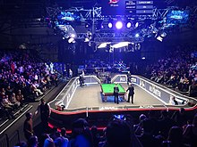 Picture of a crowd behind a snooker table