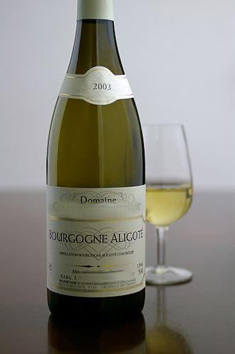 Bourgogne Aligoté AOC - A bottle and glass of Bourgogne Aligoté AOC wine.