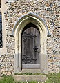 All Saints' Church, High Roding, Essex, England - chancel south door.jpg