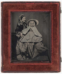 Ambrotype of a mother with baby in a bonnet (3588771425).jpg