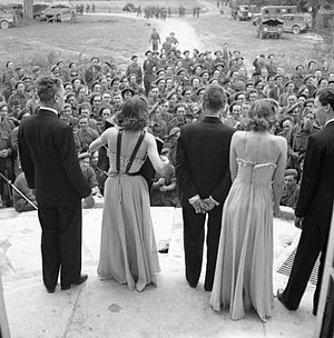 Entertainments National Service Association - An ENSA concert party entertaining troops from the steps of a chateau in Normandy, 26 July 1944