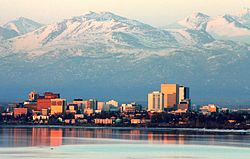 Anchorage skyline and Bootleggers Cove as photographed from Point Woronzof Park on an April evening.