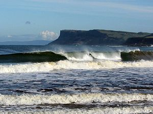 Ballycastle, County Antrim - Breakers on Antrim Coast near Ballycastle, Ireland, with cliffs of Fair Head. Scotland appears in the distance on clear days.