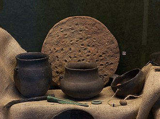 "Bronze- and Iron-Age Poland - Lusatian culture artifacts at the Bielsko-Biała Museum in Bielsko-Biała. Among the earthenware is the so-called ""clay pancake""."