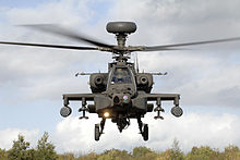 Front-end view of attack helicopter taking off