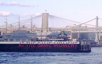 Lawrence Weiner - Weiner's At the Same Moment painted on pilings in the East River, as seen in 2011