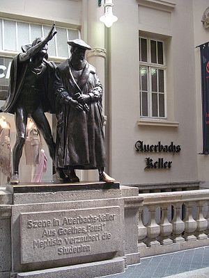 "Goethe's Faust - Sculpture of Mephistopheles bewitching the students in the scene ""Auerbachs Keller""' from Faust at the entrance of today's pub Auerbachs Keller in Leipzig"