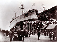 Photograph of Kearsarge. Kentucky is on her right, and crowds surround both.