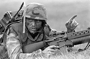 AN/PRC-77 Portable Transceiver - U.S. Marine carrying a PRC-77 during a training exercise in 1989